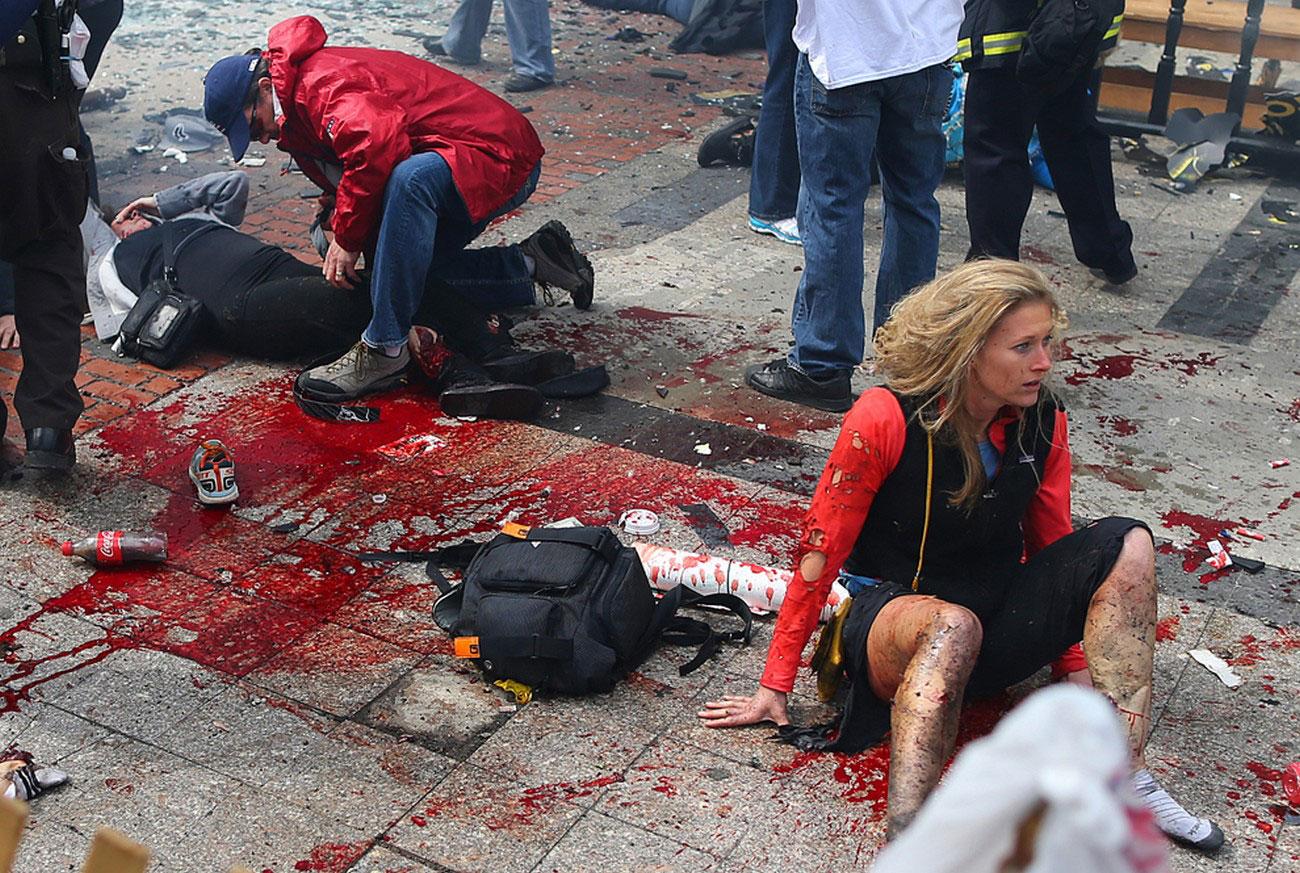 раненые люди на асфальте