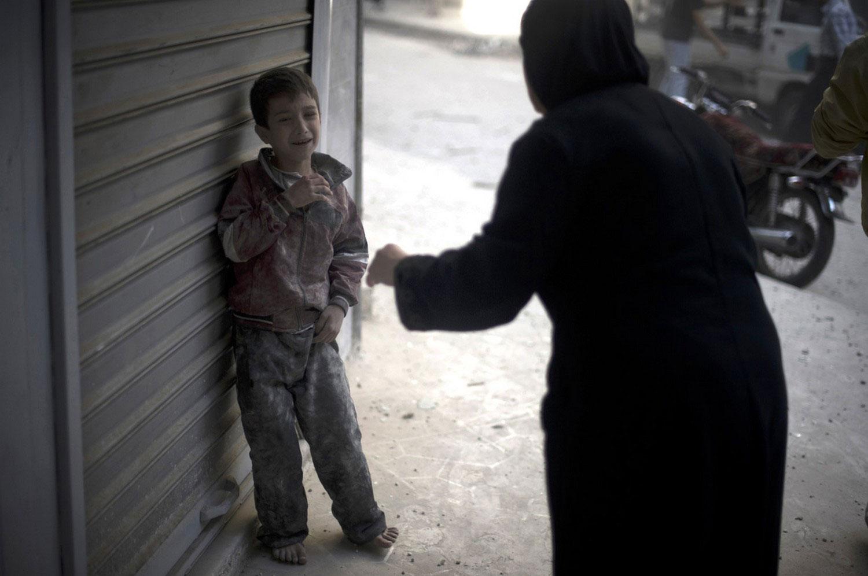 испуганный войной сирийский ребенок, фото