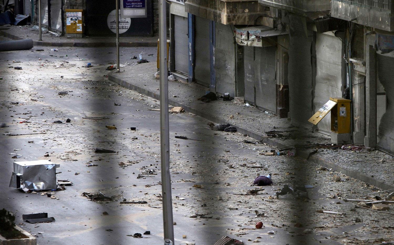 труп мужчины валяется на улицах Сирии