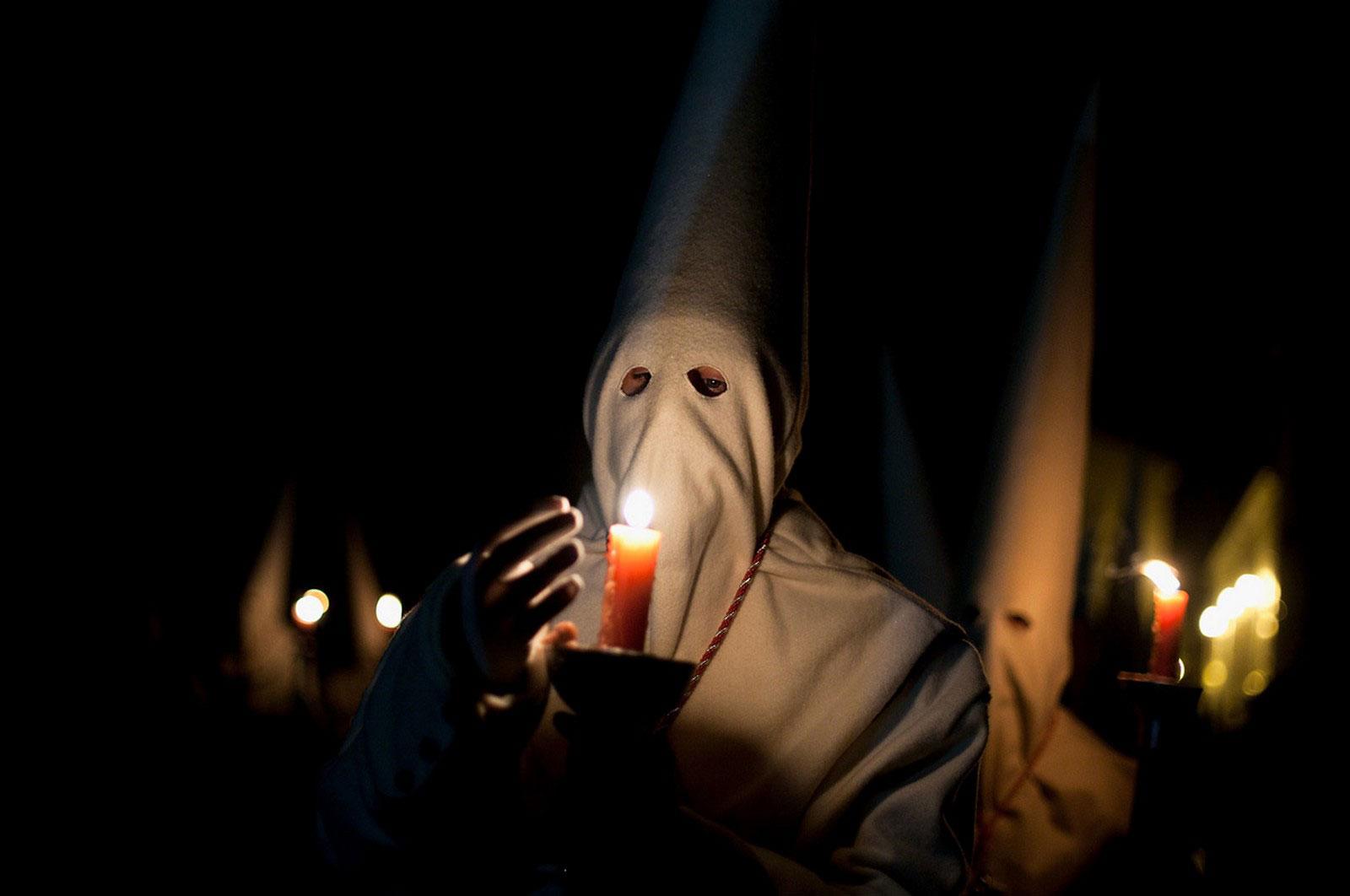 Кающийся со свечой