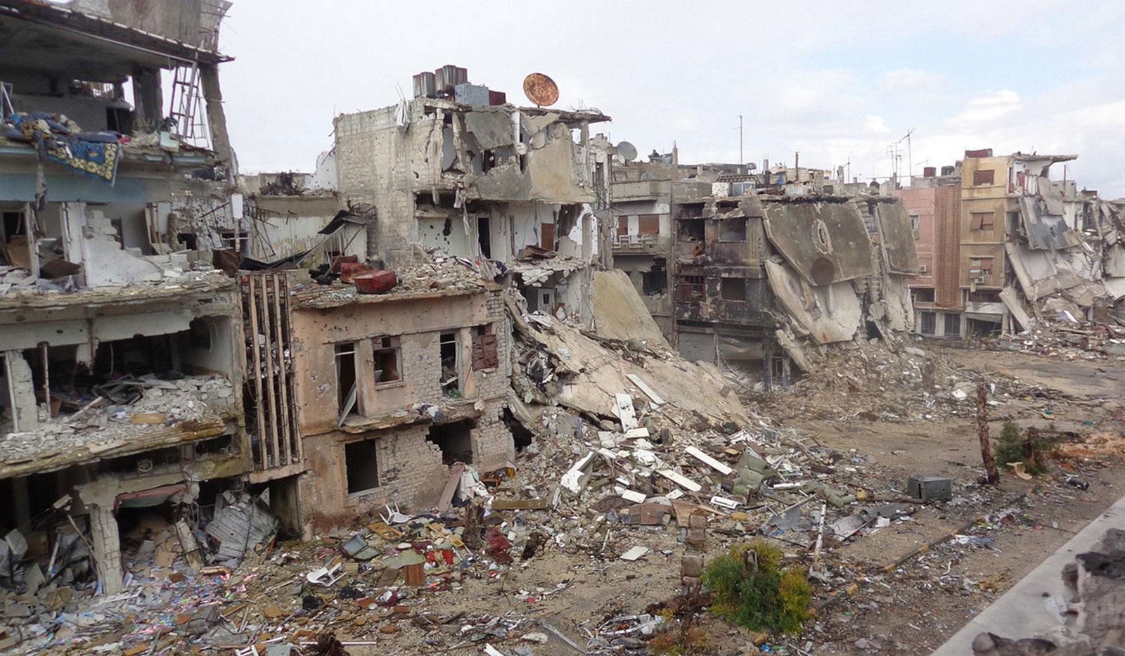 разрушенные жилые дома в Хомсе