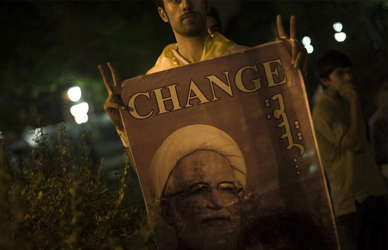 плакат с кандидатом в президенты Ирана