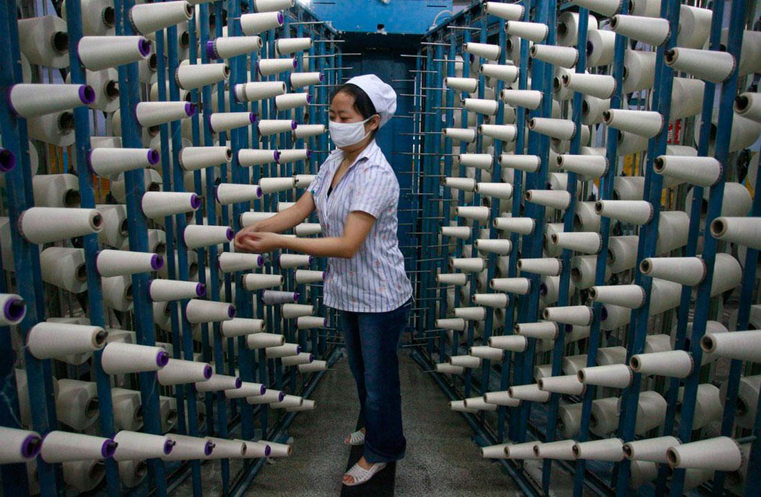 на текстильной фабрике в Суинин, фото
