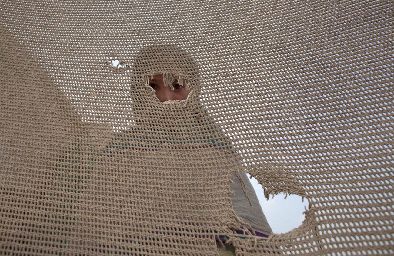 Беременная женщина в лагере переселенцев
